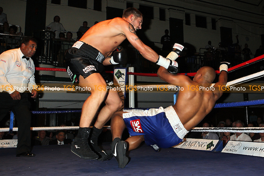 Tony Conquest (black shorts) defeats Leon Williams in a Crusierweight boxing contest for the Southern Area Title at York Hall, Bethnal Green, London, promoted by Goodwin Main Events - 07/07/12 - MANDATORY CREDIT: Gavin Ellis/TGSPHOTO - Self billing applies where appropriate - 0845 094 6026 - contact@tgsphoto.co.uk - NO UNPAID USE.