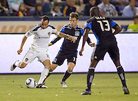 San Jose Earthquake midfielder Bobby Convey (11) and LA Galaxy forward Landon Donovan (10) battle for a loose ball. The LA Galaxy and the San Jose Earthquakes played to a 2-2 draw at Home Depot Center stadium in Carson, California on Thursday July 22, 2010.