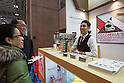 March 3, 2015, Chiba, Japan - A picture released on March 4, 2015 shows visitors speaking with a barista offering Colombia expresso at the Colombia booth area during the 40th annual International Food and Beverage Exhibition (FOODEX JAPAN 2015). Some 2,977 exhibitors from 79 nations participate in what is known to be the largest food and beverage exhibition in Asia. 75,000 buyers which include wholesalers, food service companies, and distributors are expected to attend FOODEX which runs from March 3-6. (Photo by AFLO)