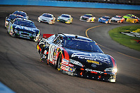 Apr 17, 2009; Avondale, AZ, USA; NASCAR Nationwide Series driver Kyle Busch (18) leads the field during the Bashas Supermarkets 200 at Phoenix International Raceway. Mandatory Credit: Mark J. Rebilas-