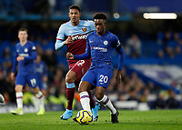 30th November 2019; Stamford Bridge, London, England; English Premier League Football, Chelsea versus West Ham United; Callum Hudson-Odoi of Chelsea is marked by Sebastien Haller of West Ham United  - Strictly Editorial Use Only. No use with unauthorized audio, video, data, fixture lists, club/league logos or 'live' services. Online in-match use limited to 120 images, no video emulation. No use in betting, games or single club/league/player publications
