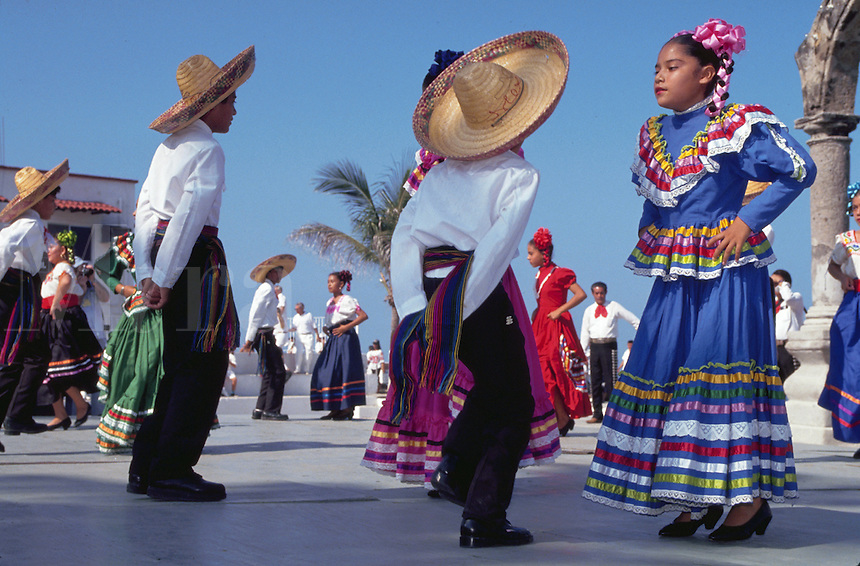 Young folkloric dancers in colorful outfits and straw hats. Puerto Vallarta, Mexico.