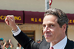 MAY 30, 2011 - Little Neck, New York, U.S. - New York Governor ANDREW CUOMO (Democrat) waves to crowds as he marches in Little Neck-Douglaston Memorial Day Parade, which honors America's veterans, on Northern Boulevard.