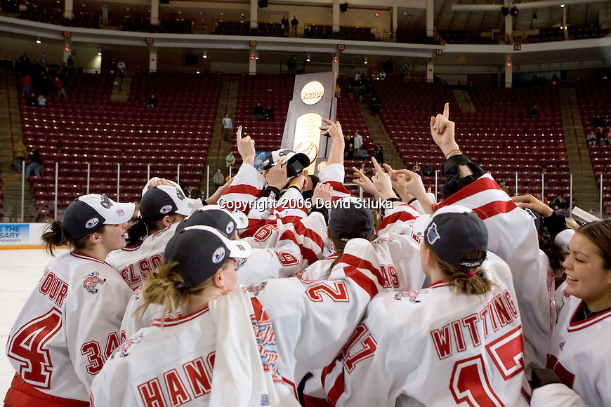 MINNEAPOLIS, MN - MARCH 26: The Wisconsin Badgers women's hockey team celebrates with the National Championship trophy after beating the Minnesota Golden Gophers at Mariucci Arena during the Women's Frozen Four Tournament final on March 26, 2006 in Minneapolis, Minnesota. The Badgers beat the Gophers 3-0. (Photo by David Stluka)