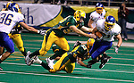 FARGO, ND - NOVEMBER 22th, 2008 : South Dakota State's Cole Brodie is tripped up during a return by Matt Voigtlander and Jeff Curtis of North Dakota State during their game Saturday evening at the Fargodome on the campus of North Dakota State University in Fargo, ND. (Photo By Ty Carlson/Inertia)