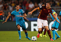 Calcio, Champions League, Gruppo E: Roma vs Barcellona. Roma, stadio Olimpico, 16 settembre 2015.<br /> Roma&rsquo;s Edin Dzeko, right, is challenged by FC Barcelona&rsquo;s Sergio Busquets during a Champions League, Group E football match between Roma and FC Barcelona, at Rome's Olympic stadium, 16 September 2015.<br /> UPDATE IMAGES PRESS/Riccardo De Luca