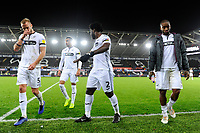 (L-R) Mike van der Hoorn, Martin Olsson, Wilfried Bony and Leroy Fer of Swansea City look dejected at full time during the Sky Bet Championship match between Swansea City and West Bromwich Albion at the Liberty Stadium in Swansea, Wales, UK. Wednesday 28 November 2018