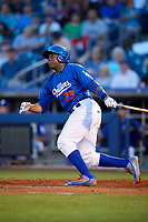 Tulsa Drillers center fielder Johan Mieses (25) follows through on a swing during a game against the Corpus Christi Hooks on June 3, 2017 at ONEOK Field in Tulsa, Oklahoma.  Corpus Christi defeated Tulsa 5-3.  (Mike Janes/Four Seam Images)