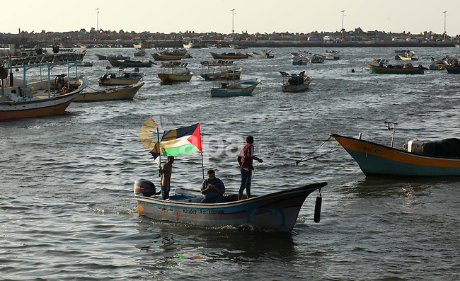 Boats are seen anchored at the Gaza seaport, on July 06, 2015. Photo by Ashraf Amra