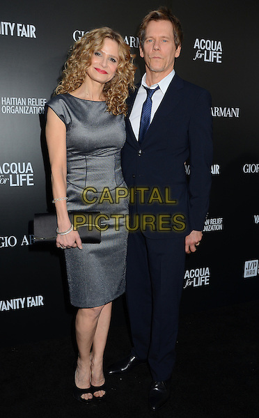 Kyra Sedgwick, Kevin Bacon.Attending the Giorgio Armani party to celebrate Paris Photo Los Angeles at Paramount Studios, Hollywood, California, USA, .25th April 2013..full length grey gray dress clutch bag blue navy suit tie white shirt couple husband wife married open toe shoes .CAP/ADM/BT.©Birdie Thompson/AdMedia/Capital Pictures