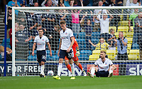 Millwall's George Saville scores the opening goal leaving Bolton Wanderers' Mark Beevers (seated) dejected<br /> <br /> Photographer Ashley Western/CameraSport<br /> <br /> The EFL Sky Bet Championship - Millwall v Bolton Wanderers - Saturday August 12th 2017 - The Den - London<br /> <br /> World Copyright &not;&copy; 2017 CameraSport. All rights reserved. 43 Linden Ave. Countesthorpe. Leicester. England. LE8 5PG - Tel: +44 (0) 116 277 4147 - admin@camerasport.com - www.camerasport.com