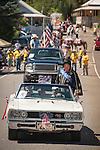 Independence Day celebration Main Street, Mokelumne Hill, California..Mr. Calaveras, Tony Boitano, as Elvis in a white Dodge convertible.