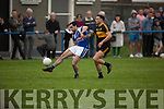 Kerins O'Rahillys Cormac Coffey been challenged by Michael Burns of Dr Crokes in the last round game of the Senior Club Championship in Strand Road on Saturday evening.