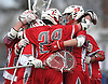 Connetquot teammates celebrate after a hard-fought 15-14 win over Huntington in a Suffolk County varsity boys lacrosse game at Huntington High School on Friday, April 7, 2017.