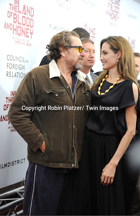 "Julian Schnabel and Angelina Jolie attends The New York Premiere of Angelina Jolie's movie "" In the Land of Blood and Honey"" on December 5, 2011 at The School of Visual Arts Theatre in New York City."
