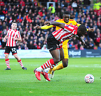 Lincoln City's John Akinde vies for possession with Northampton Town's Hakeem Odoffin<br /> <br /> Photographer Andrew Vaughan/CameraSport<br /> <br /> Emirates FA Cup First Round - Lincoln City v Northampton Town - Saturday 10th November 2018 - Sincil Bank - Lincoln<br />  <br /> World Copyright © 2018 CameraSport. All rights reserved. 43 Linden Ave. Countesthorpe. Leicester. England. LE8 5PG - Tel: +44 (0) 116 277 4147 - admin@camerasport.com - www.camerasport.com