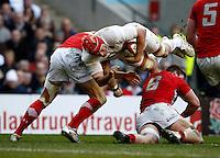 Photo: Richard Lane/Richard Lane Photography. England v Wales. 25/02/2012. England's Mouritz Botha flies as he is tackled by Wales' Dan Lydiate.