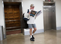 15 May 2018 - US House members have been sleeping in their offices and working out and hshowering before work. File Photo: Unidentified man reads the newspaper as he goes to the gym in the Rayburn House Office Building in Washington, DC on Tuesday, March 20, 2018. Photo Credit: Ron Sachs/CNP/AdMedia