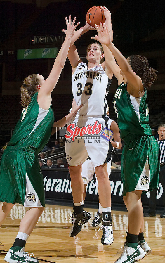 Corinne Groves (33) of the Wake Forest Demon Deacons shoots a jump shot over two Wright State Raiders defenders at the LJVM Coliseum on December 5, 2007 in Winston-Salem, NC.  Groves had 12 points in the Demon Deacons 64-46 win.