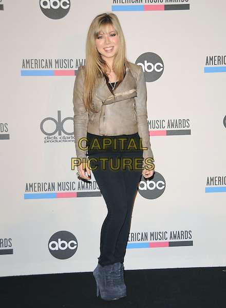 JENNETTE McCURDY .at The 2010 American Music Award Nomination Announcements held at The JW Marriott Los Angeles at L.A. Live in Los Angeles, California, USA, .October 12th 2010..Full length grey gray leather jacket blue ankle boots black jeans  .CAP/RKE/DVS.©DVS/RockinExposures/Capital Pictures.