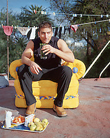 Aspiring Televisa Soap Opera actor who attends the school of Acting Televisa, has breakfast on his roof in the condesa neighbourhood of mexico city. 2-6-04
