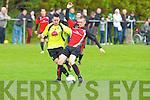 St Brendans Park's Mark O'Sullivan holds off the challenge of Killarney Celtic's Pa McCarthy in the premier league final at Mounthawk Park, Tralee on Sunday.