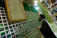 A man praying at the Mausoleum of Ayatollah Khomeini in Tehran, Iran May 9,  2007.