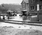Cars navigate the flooded streets of Waterbury during the flood of 1924.