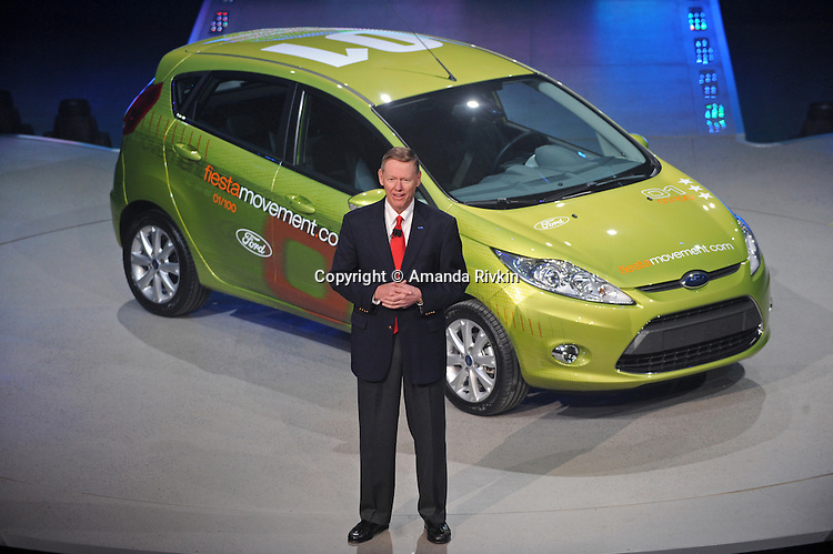 Alan Mulally, CEO of Ford, delivers a speech in front of the Ford Fiesta during the Ford presentation at the Detroit Auto Show in Detroit, Michigan on January 11, 2009.