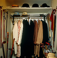 Hats and a collection of overcoats is stored together with the Duke of Windsor's golf clubs and walking sticks in a walk-in wardrobe in his dressing room