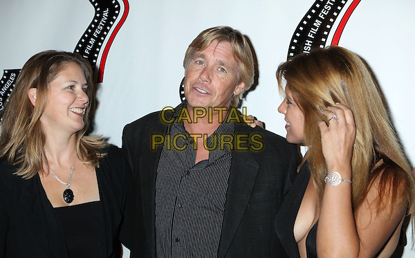 guest, Christopher Atkins, Michelle Alexandria <br /> 13th annual Polish film festival at American Cinematheque's Egyptian Theatre, Hollywood, California, USA.<br /> 9th October 2012<br /> headshot portrait black shirt suit jacket stripe cleavage profile <br /> CAP/ADM/RE<br /> &copy;Russ Elliot/AdMedia/Capital Pictures