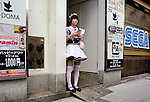"""August 30, 2011 - Tokyo, Japan - A maid cos-player hands out leaflets on the street to try and get customers to visit a maid cafe she is promoting in the Akihabara district. Akihabara is a well-known district in Tokyo for people who have obsessive interests particularly in manga, anime or video games. The Japanese term used for these types of people is called """"otaku."""" (Photo by Yumeto Yamazaki/AFLO)"""