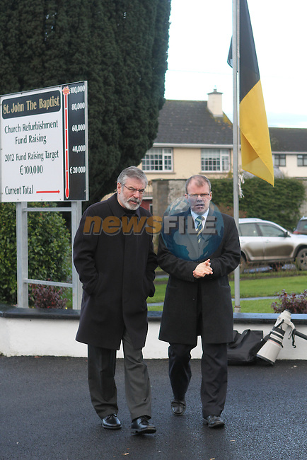 Sinn Fein's Gerry Adams and Peadar Toibin arrive at the Funeral of Minister of State Shane McEntee which took place today in Nobber, Co.Meath...Photo NEWSFILE/Jenny Matthews..(Photo credit should read Jenny Matthews/NEWSFILE)
