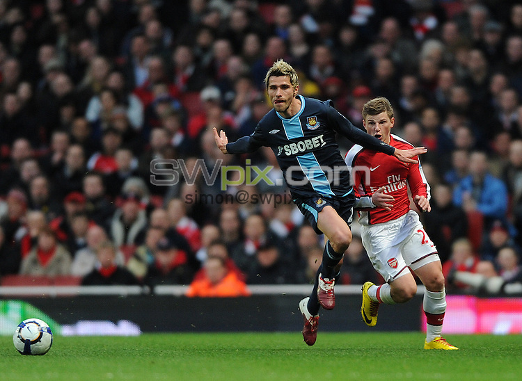 PICTURE BY JEREMY RATA/SWPIX.COM. Barclays Premier League 2009/10 - Arsenal v West Ham United - Emirates Stadium, London, England. 20th March 2010. Arsenal's Andrey Arshavin and West Ham's Valon Behrami compete for the ball..Copyright - Simon Wilkinson - 07811267706