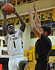 Jon Harewood #1 of St. Anthony's, left, drives to the hoop to draw a foul during a non-league varsity boys basketball game against Ward Melville at St. Anthony's High School on Thursday, Dec. 15, 2016. St. Anthony's won by a score of 52-48.