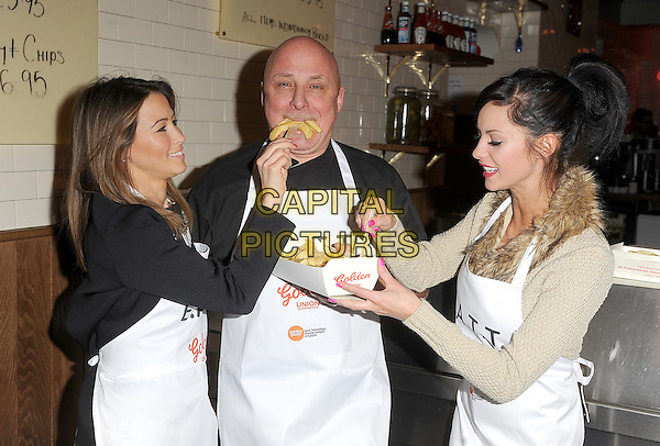 Rachel Stevens, Aldo Zilli and Jessica Jane Clement .The EATT (Eat At The Table) Launch Photocall - an Annual Event to feed the Homeless - at Golden Union Fish Bar, Oxford Street, London, England..February 8th 2012.half length black beige top white apron food fork chips french fries fur eat eating funny profile .CAP/BEL.©Tom Belcher/Capital Pictures.