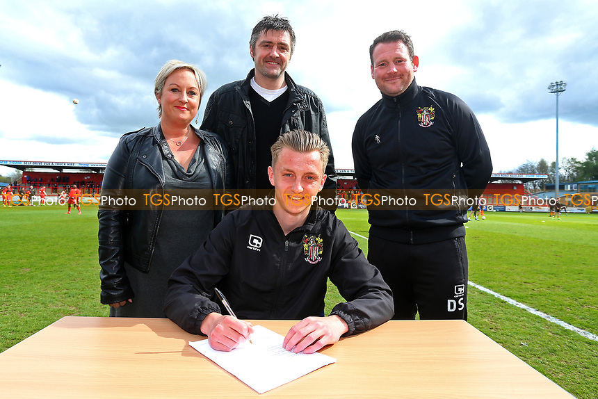 Ben Wilmot of Stevenage signs a contract with the club and poses for a photograph with manager Darren Sarll and his parents during Stevenage vs Barnet, Sky Bet EFL League 2 Football at the Lamex Stadium on 1st April 2017