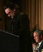As United States President George W. Bush listens, Rock singer, activist Bono speaks at the National Prayer Breakfast in Washington, DC on February 2, 2006. <br /> Credit: Dennis Brack - Pool via CNP