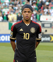 Mexico's Giovani dos Santos waits for the Mexican National Anthem.  Mexico defeated Costa Rica 4-1 at the 2011 CONCACAF Gold Cup at Soldier Field in Chicago, IL on June 12, 2011.