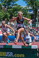 Florida State 4th-year junior and Nerinx Hall graduate Colleen Quigley pushes off a barrier during the women's steeplechase final at the 2015 NCAA Division I Outdoor Track and Field Championships. Quigley finished the race in 9:29.32 to win and make her the third fastest collegian of all-time and put her in a tie as the 9th fastest American of all-time.