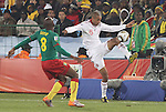 19 JUN 2010: Simon Poulsen (DEN) (15) and Geremi (CMR) (8). The Cameroon National Team lost 1-2 to the Denmark National Team at Loftus Versfeld Stadium in Tshwane/Pretoria, South Africa in a 2010 FIFA World Cup Group E match.