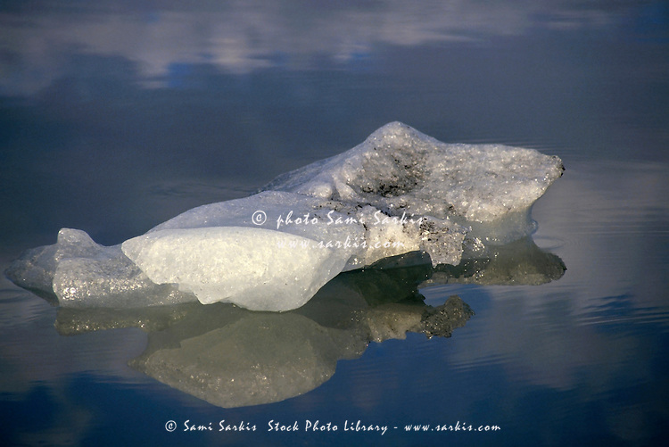 Iceberg floating in the quiet waters of Jokulsarlon, the largest glacier lake in Iceland.