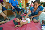Blanca Magali Sano Ramirez stimulates her 2-year old daughter Yoali Ixchel Jarquin during a session of the early intervention program of Piña Palmera, a center for community based rehabilitation for people living with disabilities in Zipolite, a town in Oaxaca, Mexico. The girl lives with some developmental disability.