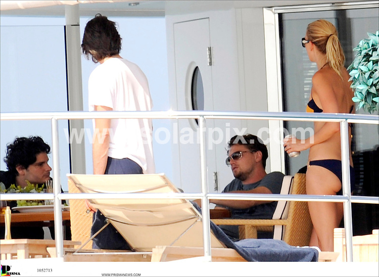 **ALL ROUND PICTURES FROM SOLARPIX.COM**.SYNDICATION RIGHTS FOR UK, CANADA, USA, SOUTH AFRICA, SOUTH AMERICA, DUBAI, AUSTRALIA, NEW ZEALAND, GREECE, ASIA.Hollywood movie hunk Leonardo Di Caprio looked relaxed and laid back as he chatted with his glamourous guests on board his luxury holiday yacht on the coast of Ibiza,.JOB REF:  6949   SPA    DATE: 03.08.08.**MUST CREDIT SOLARPIX.COM OR DOUBLE FEE WILL BE CHARGED* *UNDER NO CIRCUMSTANCES IS THIS IMAGE TO BE REPRODUCED FOR ANY ONLINE EDITION WITHOUT PRIOR PERMISSION*