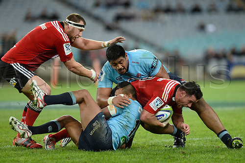 23.05.2015.  Sydney, Australia. Super Rugby. NSW Waratahs versus the Crusaders. Crusaders centre Ryan Crotty is tackled by Waratahs lock Will Skelton. The Waratahs won 32-22.