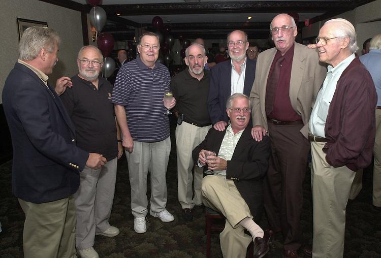 Joe Dombroski, Bob Luckey, Stan Wolfson, Don Norkett, Dick Kraus, and Tom Maguire seen gathered around John Cornell at his retirement party on October 10, 2000. Photo by Jim Peppler. Copyright/Jim Peppler-2000