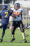 Santa Monica, CA 10/17/13 - unidentified Santa Monica player(s) and Mark Pilato (Peninsula #71) in action during the Peninsula vs Santa Monica Junior Varsity football game at Santa Monica High School.