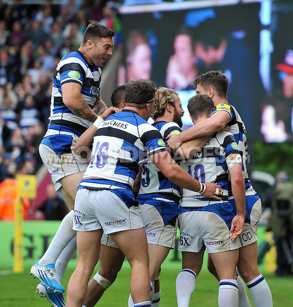 Bath players congratulate George Ford on his try. Aviva Premiership match, between Harlequins and Bath Rugby on May 10, 2014 at the Twickenham Stoop in London, England. Photo by: Patrick Khachfe / Onside Images