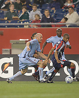New England Revolution defender Darrius Barnes (25) attempts to gather in ball as Colorado Rapids forward Conor Casey (9) closes. The New England Revolution tied the Colorado Rapids, 1-1, at Gillette Stadium on May 16, 2009.