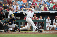 Florida State Seminoles third baseman Drew Mendoza (22) follows through on his swing against the Michigan Wolverines in Game 6 of the NCAA College World Series on June 17, 2019 at TD Ameritrade Park in Omaha, Nebraska. Michigan defeated Florida State 2-0. (Andrew Woolley/Four Seam Images)